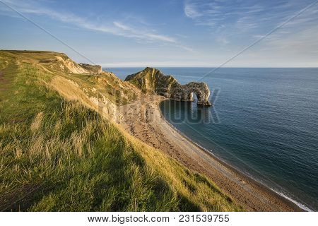 Beautiful Landscape View Of Durdle Door On The Jurassic Coast At Sunset