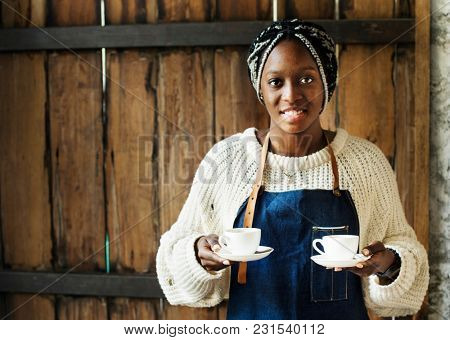 A barista serving coffee