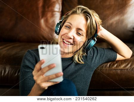 A woman listening to the music