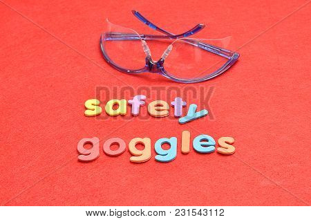 Safety Goggles With The Words Safety Goggles On A Red Background