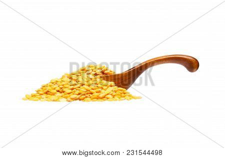 Dried Yellow Peas In The Wooden Spoon, Isolated On White Background.