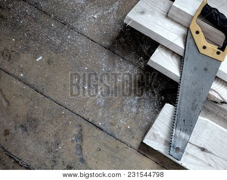 New Fresh Boards And Saw On Aged Wooden Surface (floor Or Table). Abstract Background. Natural Mater