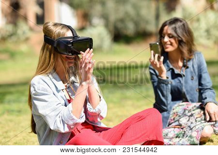 Woman Looking In Vr Glasses And Gesturing With His Hands Outdoors