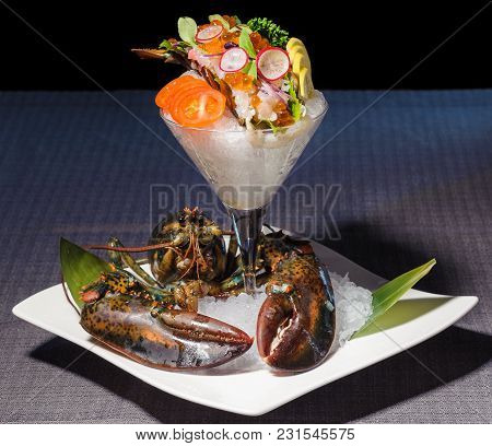 Cup With Lobster Sashimi, Served On Ice With Lime, Radish, Tomatoes And Caviar, Half Of A Lobster Po