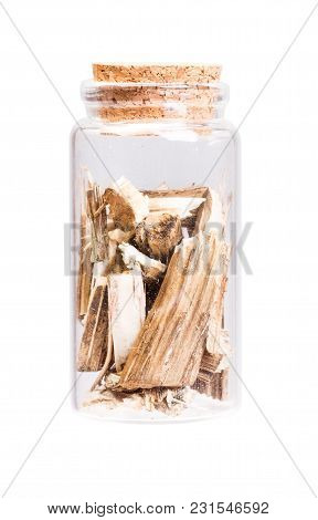 Dry Burdock In A Bottle With Cork Stopper For Medical Use. High Resolution Photo