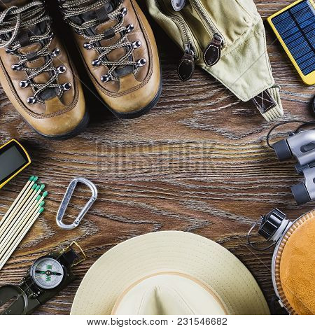Hiking Or Travel Equipment With Boots, Compass, Binoculars, Matches On Wooden Background. Active Lif