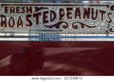 Rimini, Italy - July 2017: Vintage Silvery Sign With Words Fresh Roasted Peanuts.