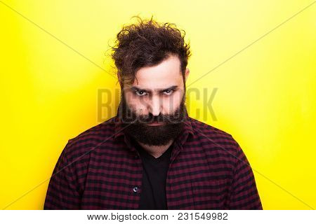 Sad Bearded Hipster Man On Yellow Background