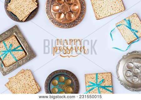Jewish Holiday Passover Frame Composition With Matzo And Seder Plate On White Background. View From