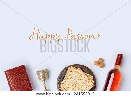 Jewish Holiday Passover Frame Composition With Wine, Matzo And Seder Plate On White Background. View