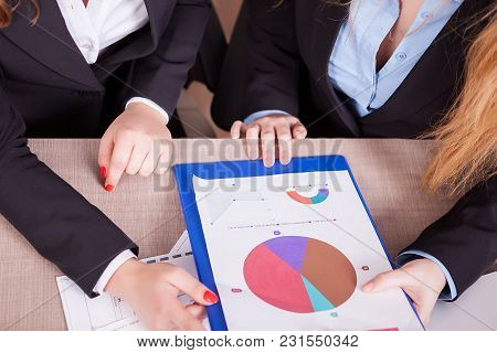 Top View Of Woman Hands Analyzing Charts And Data