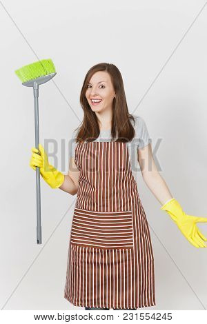 Young Smiling Housewife In Striped Apron, Yellow Gloves Isolated On White Background. Housekeeper Wo