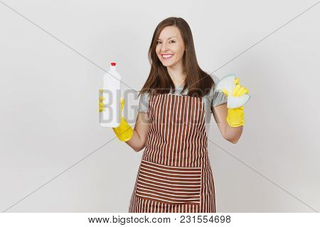 Young Smiling Housewife In Yellow Gloves, Striped Apron Isolated On White Background. Attractive Wom