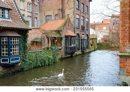 Canal In Historic Centre Of Bruges Or Brugge, Belgium With Buildings In Medieval Style