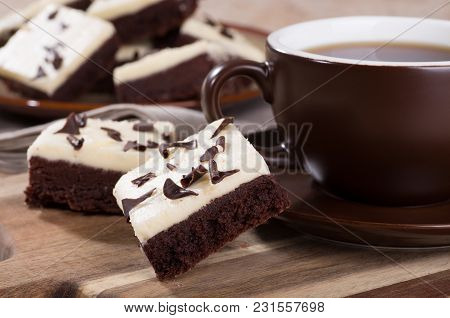 Closeup Of Two Chocolate Fudge Brownies With A Cup Of Coffee On A Wooden Tray