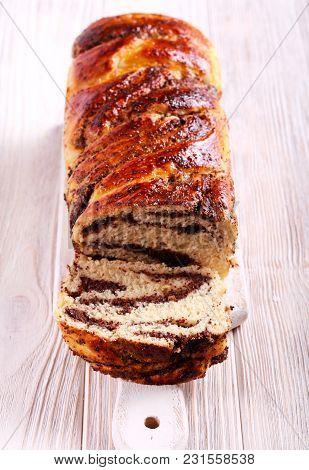 Poppy Seed And Fruit Filling Braided Loaf On Board