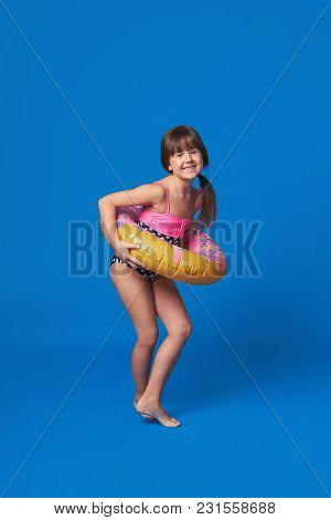 Beach Vacation Concept.happy Cute Little Girl Smiling Holding A Swimming Ring On Body. Pretty Fashio