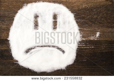 Face Of A Sad Smiley Made With Granulated Sugar. The Picture Illustrates The Harm Of Eating Sugar An