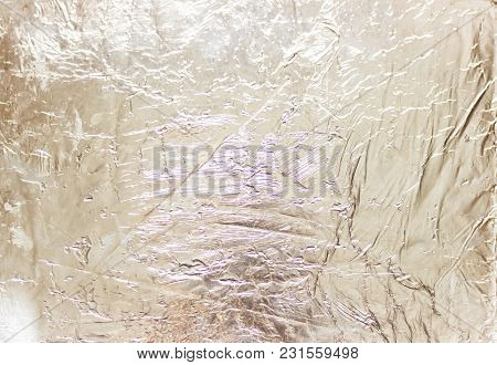Silver Foil Background With Shiny Crumpled Surface For Texture Background.