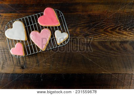 Frosted Heart Cookies With Copy Space To Right Over Dark Wooden Table