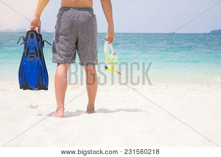 Vacation Backside Of Man Holding Snorkeling Gear On Tropical On The Beach On Summer Travel Destinati