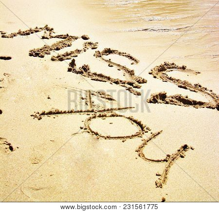Romantic Words Written On The Sand On The Beach