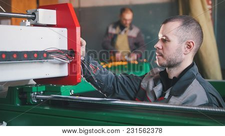 Portrait Of Electrician On Overalls Is Working With Energy Panel And Machinery Equipment On Plant, C
