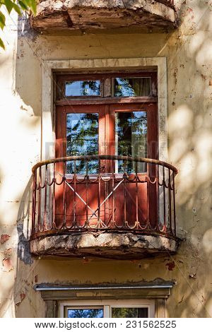 The Balconies Of An Old Building In Tallinn, Estonia Are In A Bad Shape. There Is A Drying Rack On O