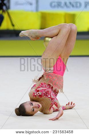 Kyiv, Ukraine - March 16, 2018: Rhythmic Gymnast Carmen Whelan Of Canada Performs With Ball During R