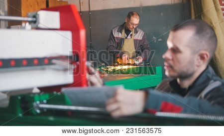Portrait Of Electrician Builder Engineer During Work, Close Up