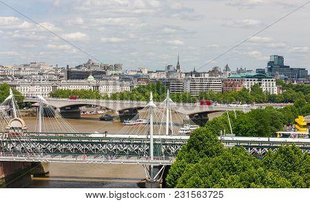 Hungerford Bridge And Waterloo Bridge Across River Thames, London, England