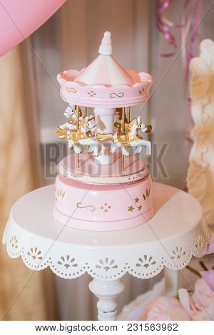 Old Vintage Wooden White And Pink Merry Go Round Carousel On Decorative Stand. Birthday Party Decora