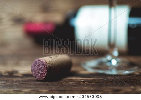 Still Life With A Cork And A Bottle Of Wine On An Old Tree