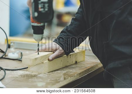 Master Carpenter Working On Woodwork Using Electric Tools