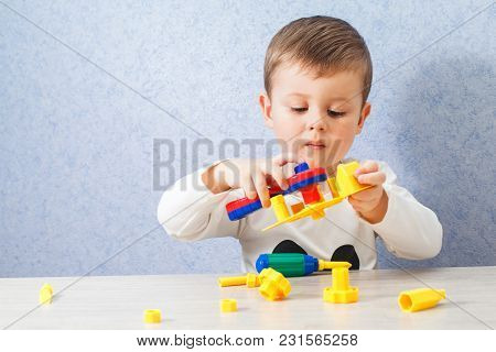 Cute Little Boy Is Playing With Tools. A Toddler Working With Toy Tools.