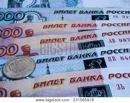 Russian Coin Lies On Several Banknotes Of The Bank Of Russia