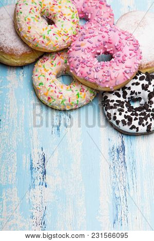 Traditional Donuts On White Wooden Background.  Tasty Doughnuts With Icing And Powdered Sugar, Copy