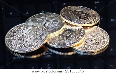 Decorative Coins Of Crypto Currency On A Gray Mirror Background