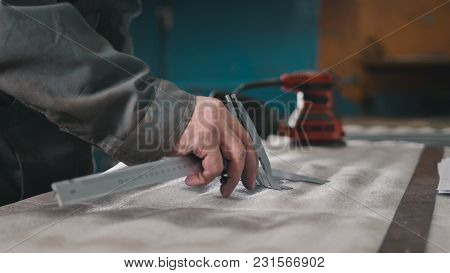 Worker Making Measurements And Marks On The Metal Part Using A Caliper, Industrial Concept