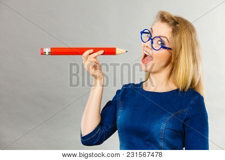 Positive Joyful Woman Blonde Student Girl Or Female Teacher Wearing Nerdy Glasses Holding Big Red Pe