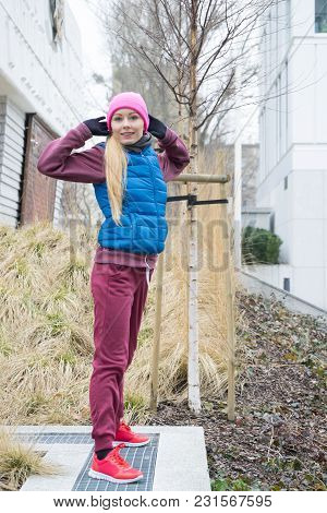 Sport And Recreation. Fit Slim Sporty Teen Girl Stretching Warming Up Outdoor In Park. Woman Exercis