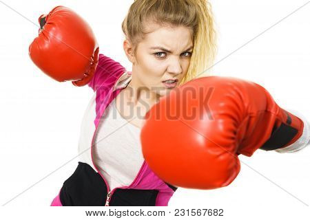 Sporty Angry And Agressive Woman Wearing Red Boxing Gloves, Fighting. Studio Shot On White Backgroun