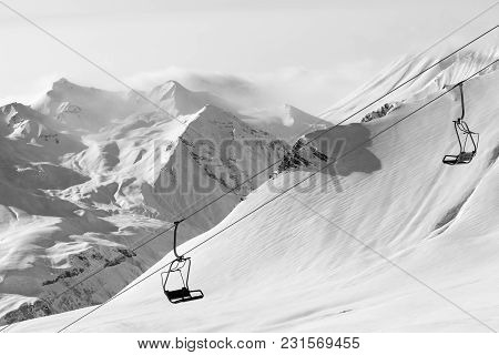 Chair Lift At Ski Resort At Winter Day. Caucasus Mountains, Georgia, Region Gudauri. Black And White