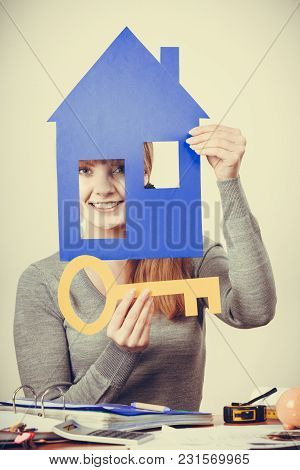 Selling And Buying Real Estate Concept. Young Blonde Smiling Positive Female Estate Agent Ready To S