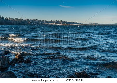 A View Of A Seattle Bridge Across Lake Washington On A  Windy Day.