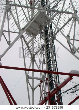 Cell Tower Constructions On The Winter Sky Background