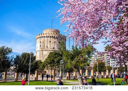 10.03.2018 Thessaloniki, Greece - White Tower Of Thessaloniki In Greece, Cherry Blossom