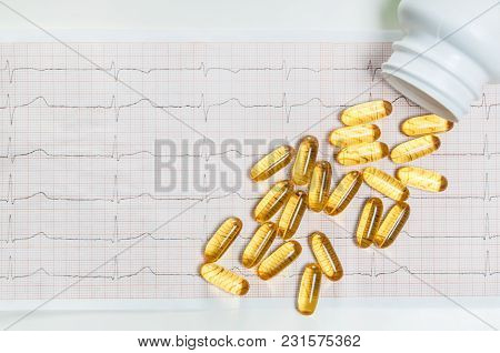 Fish Oil Capsules And Cardiogram Ecg, Healthy Heart Concept