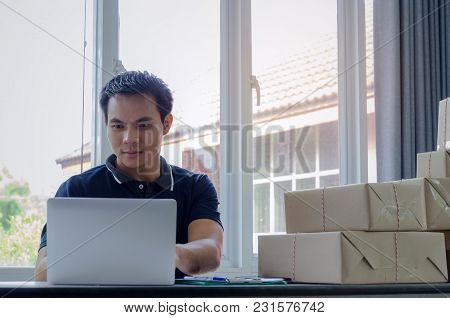 Start Up. Young Man Happy After New Order From Customer With Clip Board, Laptop Computer And Deliver