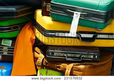 Close Up Of Pile Of Old Travel Suitcases Luggages Stacked For Transport One Above The Other In Many